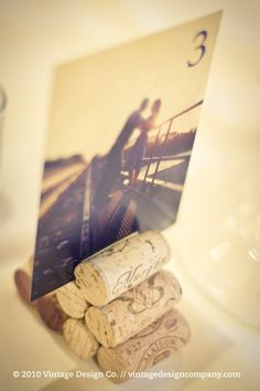 What a fun way to designate tables - engagement photos held by wine corks.  Seems like an easy DIY project!