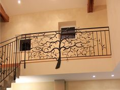 Another view of the wrought iron tree applied to a balcony railing.
