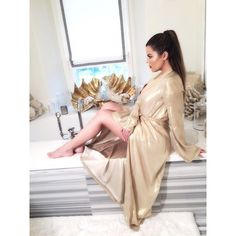 Perched on a bathtub: Khloé Kardashian showcased her slim legs in a golden dressing gown during an impromptu photo shoot in her Calabasas bathroom Thursday Koko Kardashian, Kardashian Jenner, Kardashian Style, Kardashian Fashion, Bridesmaid Dresses, Prom Dresses, Dress Prom, Sleeve Dresses, Party Looks