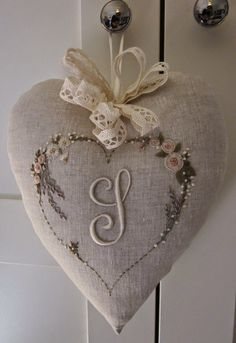 Elizabeth hand embroidery: embroidered with shades of beige and a hint of pink, lavender lilac on linen.