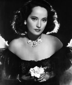 Merle Oberon wearing three Cartier flower pins on a necklace.  Dark Waters, Merle Oberon, 1944   Photo courtesy of Fine Art America