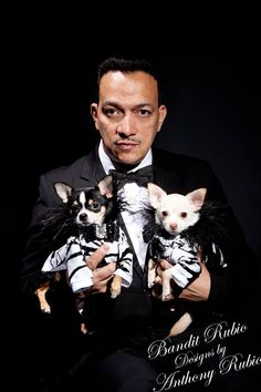 Portrait of Pet Couturier Anthony Rubio with his muses celebripups Bogie and Kimba.  Photo by Yoni Levi