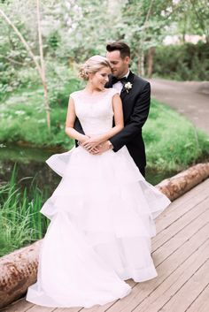Romantic bride and groom poses. Summer wedding at the Calgary Zoo. I just love this gorgeous lace and organza gown! Calgary Wedding Venues, Summer Wedding, Our Wedding, Groom Poses, Places To Get Married, Getting Married, Amanda, Waiting, Wedding Photos