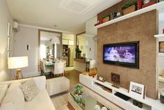 Muito utilizado nos apartamentos, os painéis com televisão embutida são uma ótima solução para otimizar espaço e decorar o ambiente. Esse painel está com revestimento em tecido, uma boa alternativa para redução de custo na escolha dos acabamentos http://ow.ly/9jray #tecnisa