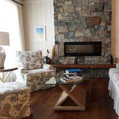 Such pretty fabrics and great fireplace #muskoka #cottagestyle