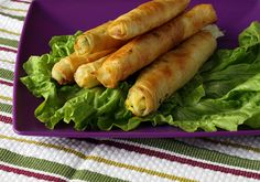 Sigara Böreği / cigar-shaped traditional Turkish pastry with toasted crust and wonderfully moist cheese and parsley stuffing