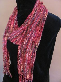 Handwoven scarf made from novelty yarns in the warp and dyed tencel in the weft. http://www.flickr.com/photos/ragmamarag/