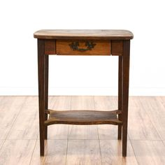 This end table is featured in a solid wood with a distressed mahogany finish. This country farmhouse style side table has a single spacious drawer, bottom tier, and iron handle pulls. Perfect for holding drinks! #countryfarmhouse #tables #endtable #sandiegovintage #vintagefurniture