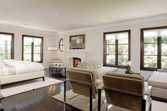 Love the wood window frames with the cream/white - nice taste Miss K Kardashian