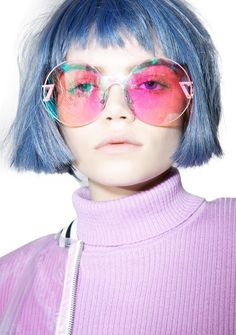 ESQAPE Seemore Pink Hologram Sunglasses cuz nothing gets past your line of sight… These incredible sunglasses feature sikk pink metal arms with rectangular cutouts, unique oversized circular lens plate, and holographic pink lenses.