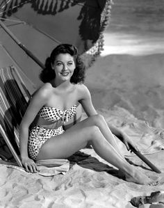 "Ava Gardner wearing a ""back-in-fashion bikini "" that would be great when one needs a little extra coverage. I love it"