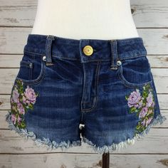 """[AE] Embroidered Cutoff Short Festival Floral Boho Awesome pair of denim cutoffs with pretty floral embroidery. Flattering higher cut on the sides. Perfectly distressed and frayed!  Waist: 14.5"""" Rise: 8"""" Inseam: 2"""" Condition: EUC. No flaws.  No Trades! American Eagle Outfitters Shorts Jean Shorts"""