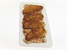 Food Network invites you to try this Chicken Milanese with Tomato and Fennel Sauce recipe from Giada De Laurentiis. kdid09