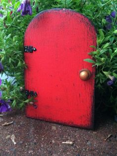 Garden Fairy door red distressed by WoodenBLING on Etsy, $13.00  Such a fun idea to start with grandklds, telling them fairies live in your tree!