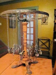 old bicycle wheel as jewelry display fixture... going to make this for all Maddie's jewelry! Already have the bike wheel :)