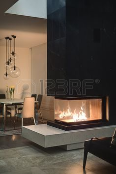 Spacious Home with a Warm Interior in Kiev - Design Milk Home Fireplace, Modern Fireplace, Fireplace Surrounds, 3 Sided Fireplace, Black Fireplace, Fireplaces, Interior Design Living Room, Living Room Designs, Interior Decorating