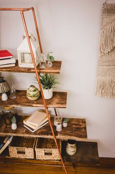 Save space and add a simple, yet elegant design element to any room with this DIY ladder shelf that incorporate on trend copper details. Build yours with these ladder shelf plans to day! Ladder Shelving Unit, Ladder Shelf Diy, Ladder Bookshelf, Frame Shelf, Bookshelves, Ladder Decor, Pipe Shelves, Diy Projects To Build, Arts And Crafts Projects