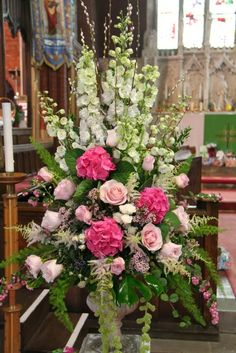 Magnificent pedestals designs Delphiniums, Roses and Hydrangeas Tablescape Centerpiece www.tablescapesbydesign.com https://www.facebook.com/pages/Tablescapes-By-Design/129811416695