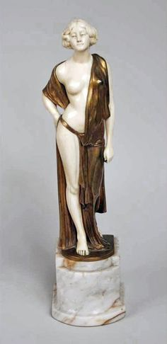 A bronze and ivory sculpture depicting a semi-nude by Gladenberg. Made in Germany Circa: 1925 Signature: Gladenberg