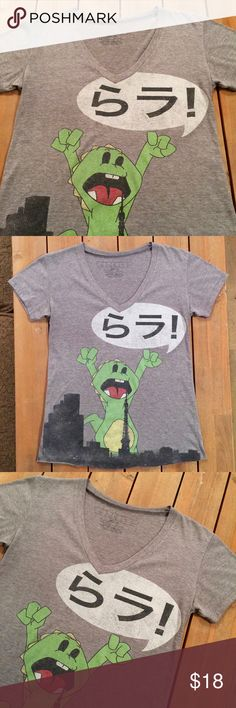 URBAN OUTFITTERS . GODZILLA T SHIRT GOJIRA !!!  super cute super soft worn in Vneck graphic tee from urban with unfinished hem  this one is fairly stretchy it's a poly / cotton / rayon blend  good used condition  workshop brand   measurements approx  pit to pit = 18.5 inches shoulder to shoulder = 16.5 inches length = 24 3/8 inches  machine wash made in USA  coming to you from my smoke free casita Urban Outfitters Tops Tees - Short Sleeve