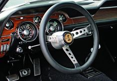Image 10 of 16: Photo Courtesy: Eric English ...to a properly done Bullitt tribute. The Interior Decor Group includes the woodgrain dash, but the steering wheel is a period aftermarket piece offered through Shelby.