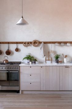 Kitchen interior decor by INGREDIENTS LDN with kitchen plants in beautiful plant pots as part of a natural kitchen with raw wood, marble and copper Kitchen And Bath, Kitchen Decor, Kitchen Ideas, Kitchen Trends, Tudor Kitchen, Kitchen Plants, Kitchen Stuff, Rustic Kitchen, Interior Design Kitchen