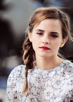 Emma Watson's hair and makeup are both super cute.