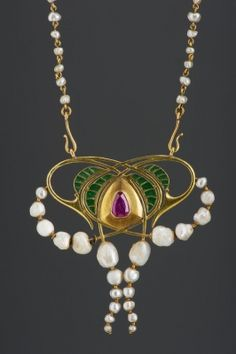 Pendant with chain. Gold, pearl and ruby. by Alexander Abt abbot (designer) and Tarjan (Huber) Oscar. Hungary,  circa 1905