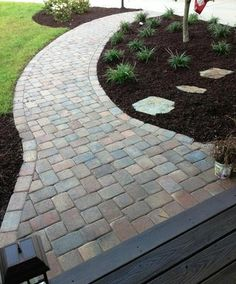 Decorative paver sidewalk leading to the front porch. | Yelp
