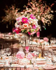 Go pink or go home! We love seeing a design concept that embraces a single colour palette and the Ritz Carlton #Toronto was the perfect venue to transform into a pink wedding wonderland! | Photography By: Ikonica | WedLuxe Magazine | #luxury #wedding #luxurywedding #weddinginspiration #pink #floral #centrepiece #fuchsia #tablescape #reception #decor