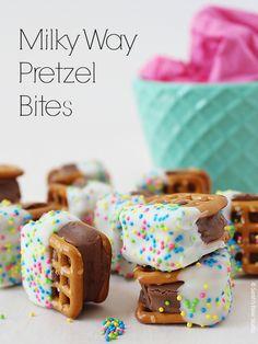 Milky Way Pretzel Bites – chewy, caramel-y, chocolatey Milky Way minis sandwiched between crunchy, salty pretzels, dipped into creamy white chocolate.