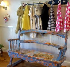 Nautical entryway with rustic wood bench and oar paddle coat rack: http://www.completely-coastal.com/2014/10/coastal-pastels.html