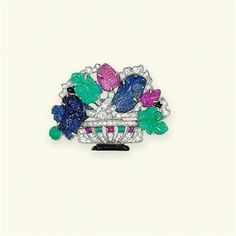 AN ART DECO GEM-SET GIARDINETTO BROOCH Designed a bouquet of carved sapphire, emerald and ruby foliage in a circular-cut diamond vase with black onyx and gem-set detail, circa 1930, 3.8 cm wide