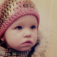 Wearing a handknit beanie , so cute