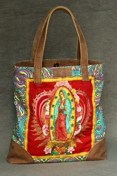 Tote Bag, Mexican pattern, with Our Lady of Guadalupe on the front. Leather handles, leather finishing. Sand color lining inside with pocket. 34cm height x33 width and 6 cm on the side. 13.5 H x 13 W x2.5 side  More information on fb: www.facebook.com/poshet   Thank you for visiting Ana