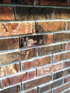 little chalk mice on a brick wall by david zinn