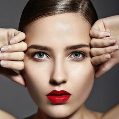 Woman with Bottom-heavy Lips and Red Lipstick