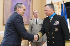 Gerard Araud, French ambassador to the United States, shakes hands with U.S. Navy Adm. James A. Winnefeld Jr., vice chairman of the Joint Chiefs of Staff, after award him the National Order of Merit medal, commander class, in Washington, D.C., May 11, 2015.