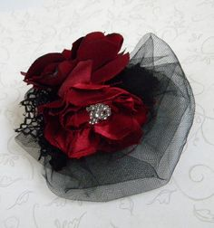 Hey, I found this really awesome Etsy listing at https://www.etsy.com/listing/178998289/handmade-silk-hair-fascinator-red-and