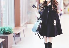 Very cute black jacket with the arm slits.