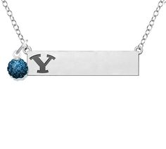 Our indicia style bar style necklace featuring the logo of your favorite team off to the side for a subtle and fashionable look, is accented with a sterling silver and crystal ball charm representing the schools color. The nameplate is made from solid sterling silver and suspended from a high quality 18 inch chain. The perfect game day necklace! Show your spirit with style!