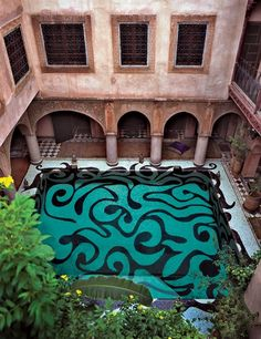 American artist Kris Ruhs created the exuberant tile pattern for this courtyard pool at the Marrakech residence of Franca Sozzani, the editor in chief of Vogue Italia.