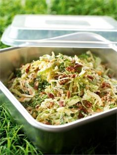 New Orleans Coleslaw  1 head white or savoy cabbage, about 1kg before trimming  2 carrots  2 sticks celery  4 spring onions  200g best-quality store-bought mayonnaise (preferably organic)  4 x 15ml tablespoons buttermilk  2 x 15ml tablespoons maple syrup  2 teaspoons apple or cider vinegar  100g pecans, fairly finely chopped  Salt and pepper to taste