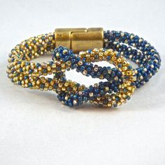 Love Knot Kumihimo Beaded Infinity Bracelet in Blue and Gold by ComplimentsByDesign on Etsy