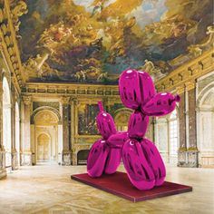 Jeff Koons' balloon dog sculpture in the Palace of Versailles, France.