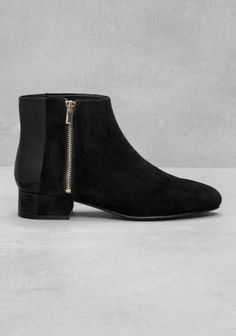 Low-ankle boots crafted from a luxe blend of nubuck and smooth leather.