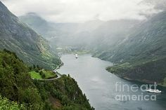 Geiranger in a cloudy and foggy day seen from above, Norway