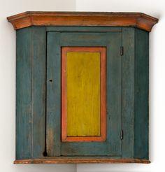 Paint-decorated hanging corner cupboard Pennsylvania, circa 1820 Est. $5,000-$8,000