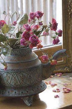 dried roses in patina pot