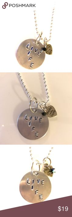 """Handmade """"Live Life"""" quote stamped necklace Hand stamped and made by me. This necklace is adorned with an iridescent Swarovski crystal. """"Live Life"""" because everyone needs a reminder to just live. Inspired by my mom because no matter how many times death knocked on her door - she decided to love and live life. ❤Stay tuned for more inspirational jewelry. Coming soon. Also bundle with other items in my closet to save even more. Jewelry Necklaces"""
